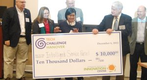 Hanover Tech Challenge winner Holly Chen accepts a check for $10,000 from William Daughtrey, head of the Dominion Resource Innovation Center. (Photo by Lena Price)