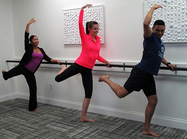 Instructor Symone Anthony, left, hits the barre with Liz Stewart and Frankie DeJesus. (Photos by David Larter)