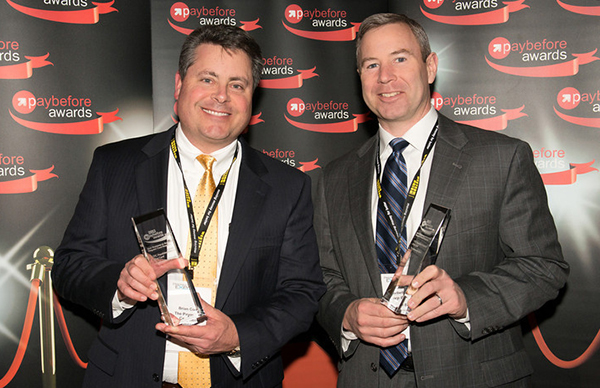 Brian Cook, senior vice president for sales and marketing at The Payments Company, and John Barbella of the Bancorp Bank at the 2013 Paybefore Awards.
