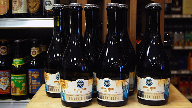 Blue Bee Cider is now on the shelves of several local stores, including Once Upon a Vine.