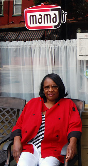 Mama J's owner Velma Johnson sits outside her restaurant. (Photo by Lena Price)
