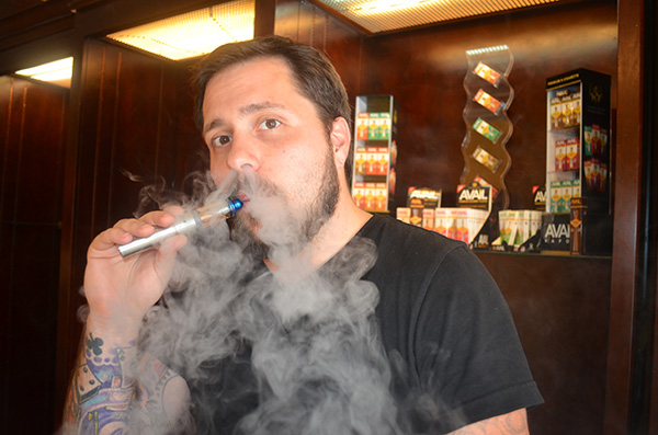 Avail Vapor co-founder Donovan Phillips demonstrates his product. (Photos by Mark Robinson)