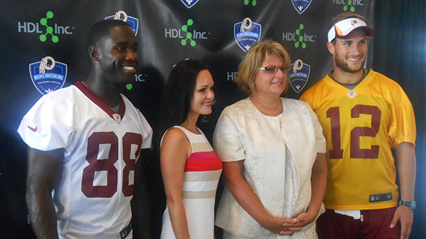 Redskins wide receiver Pierre Garçon, left, HDL chief medical officer Tara Dall, HDL chief executive Tonya Mallory and Redskins quarterback Kirk Cousins. (Photo by Burl Rolett)