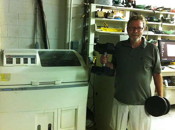 David Davies with his recently patented dumbbells and 3D printer.