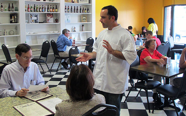 Owner and head chef Patrick Harris talks to diners at Boka Kantina. (Photos by Michael Thompson)