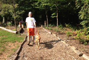 James Tilson taking a stroll with Cooper.