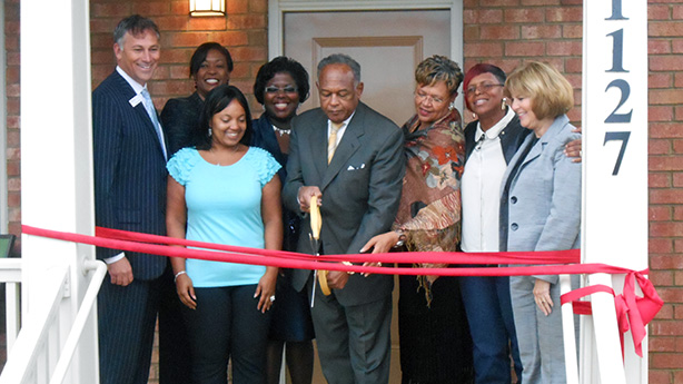 At the opening: Gary Gore, Bank of America Virginia state president, left; Dionne Nelson (back row), Laurel Street Residential chief executive; Tasha Burgo, Highland Grove resident; Adrienne Goolsby, Richmond Redevelopment and Housing Authority chief executive; Mayor Dwight Jones; City Council member Ellen Robertson; Penny Gregory, owner of A Penny for Your Thoughts Cleaning Services; and Susan Dewey, Virginia Housing Development Authority executive director. (Photos by Burl Rolett)