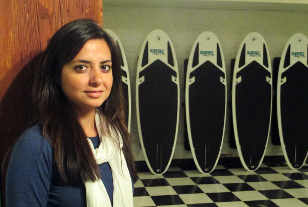 Shockoe Slip Yoga founder Rose Maghdouri and her surf yoga boards. (Photos by Michael Thompson)