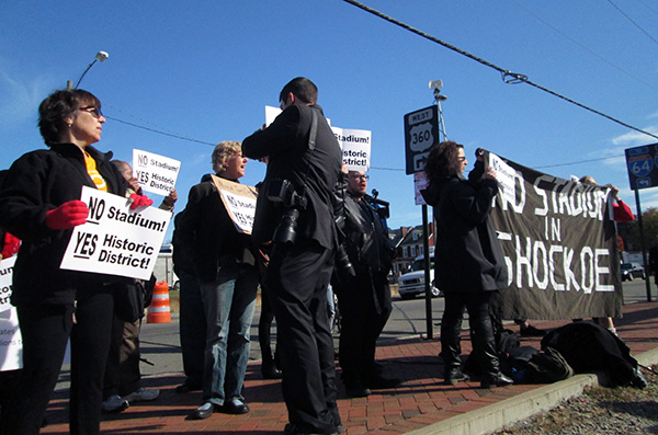 About 70 people protested the stadium plan.