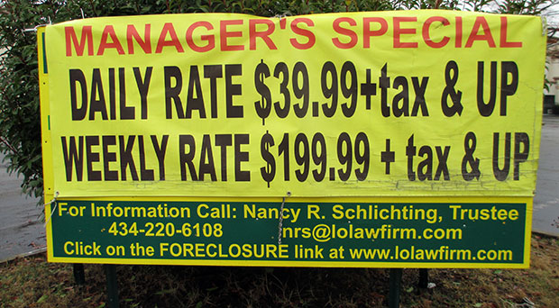 """A """"manager's special"""" banner draped over the foreclosure sign."""