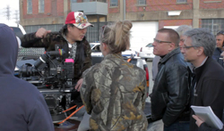 Director Sunny Zhao goes over the plan for the shoot.