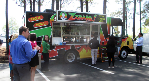 Derek Cha, founder of Sweet Frog, unveils his newest business -- Korean barbecue food truck Zzaam! (Photo by Michael Thompson)
