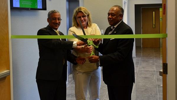 Health Diagnostics Laboratory CEO Tonya Mallory, Mayor Dwight Jones, and Rep. Bobby Scott mark the completion of Health Diagnostic Laboratory's  $100 million headquarters. Courtesy of HDL.