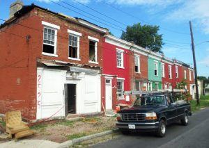 The string of houses was originally long-neglected and covered in colorful paint.  Photo by Brandy Brubaker, June 2014.