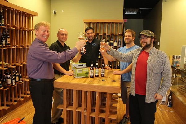 De Fles Winkle owner Lou Dicello, Adam Grayberg and  Joseph Miller of Specialty Beverage and Wink employees Eric Wise and Paul Radabaugh toast to .... Photo by Michael Thompson.