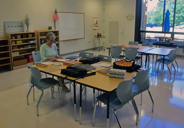 Mary Hogan prepares her classroom for the return of upper school students at Richmond Montessori. Photos by Brandy Brubaker.