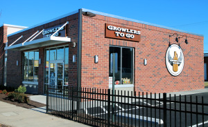 A Starbucks is going up next to Growlers to Go.
