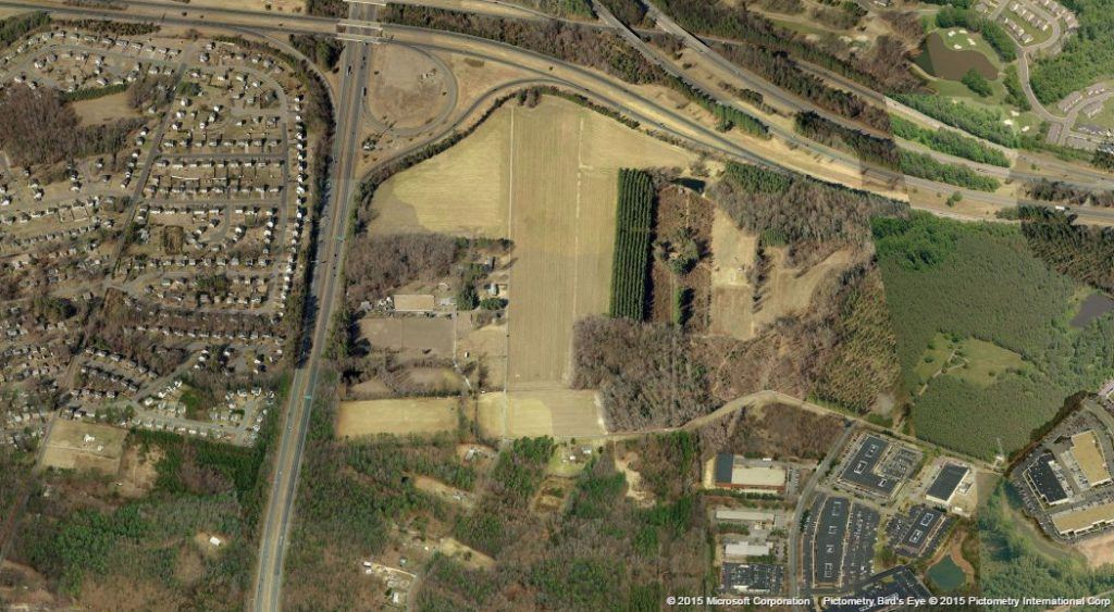 A nearly 100-acre plot of land on Scott Road is under new ownership. Image courtesy of Bing Maps.