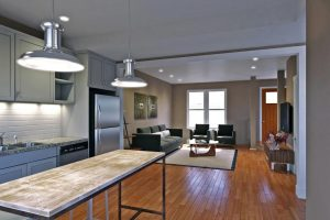 A rendering of the first floor of one of the three-story townhomes, which will vary between three- and four-bedroom units.