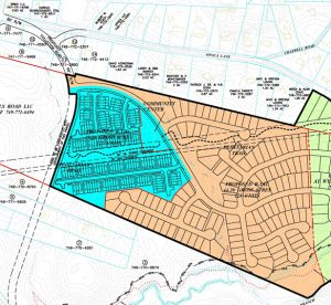 The plans call for up to 130 single-family houses and 130 townhomes on a total of 63 acres.