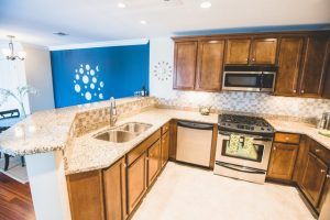 Kitchens include granite counters and gas stoves.