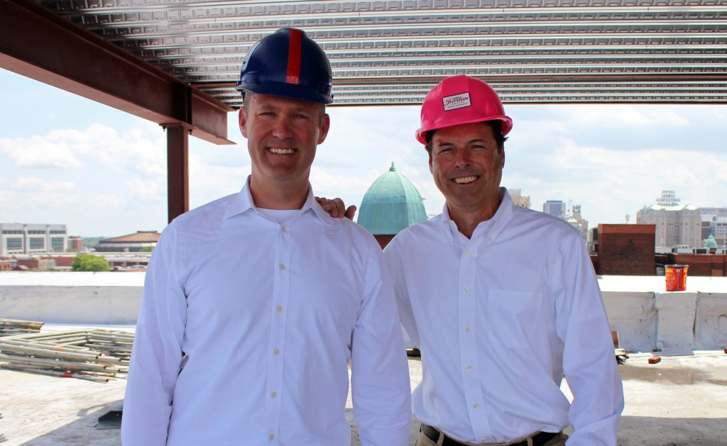Kiniry (left) and Ted Ukrop during a hard-hat tour of the upcoming Quirk Hotel. Photos by Katie Demeria.