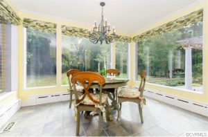 The home includes a sunroom and a screen porch.
