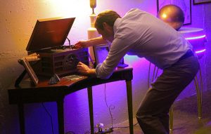 A Sports Backers employee works to dig up a clue at Escape Room RVA. Photos by Michael Thompson.