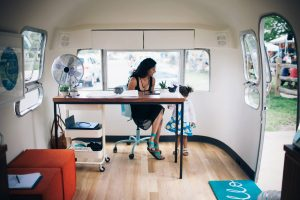 Rupa Singh works in the Airstream at Good Day RVA.