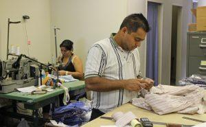 Maria Argueta and Abel Mendoza sew custom shirts at Creery.