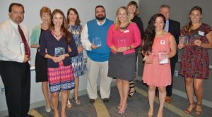 Free Agents Marketing staff and other winners display their awards from the Hampton Roads Chapter of the PRSA.