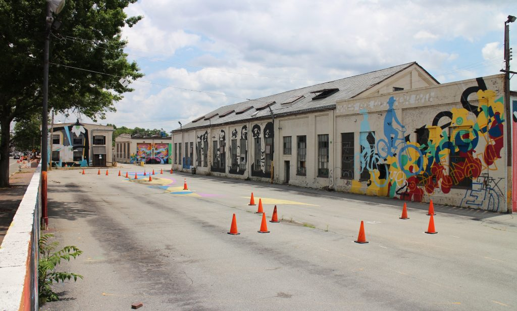 The bus depot's nine vacant buildings are covered in murals. Photos by Michael Thompson.