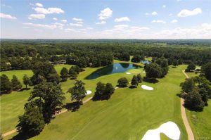 The home overlooks the James River Course's ninth hole.