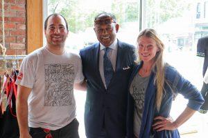 Mayor Dwight Jones (center) visits with