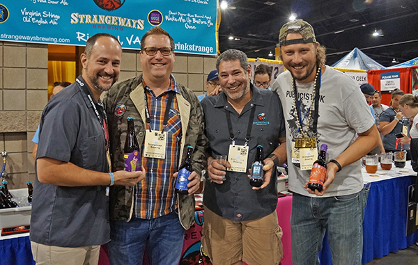The team from Strangeways Brewing Company. From right, business developer Lars  Zachariasse, head brewer Mike Miller and founder Neil Burton. Far left, Chris Holder from  Capital Ale House in Richmond.