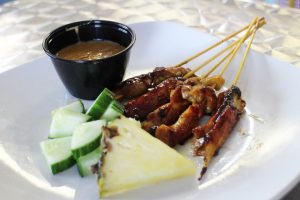 Satay is a popular Southeast Asian dish of skewered meat often served with peanut sauce.