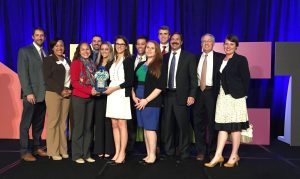 DHG accepts its Young Professional Workplace Award.
