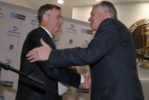 Thomas Farrell, left, Chairman, President and CEO of Dominion, shakes hands with Virginia Gov. Terry McAuliffe, after Farrell announced that the Virginia Values Veterans, was selected as the recipient of the proceeds from the Dominion Charity Classic. The V3 program is designed to ease the transition of military veterans to civilian careers. Dominion is the title sponsor of the PGA Champions tournament. (Dominion Photo)
