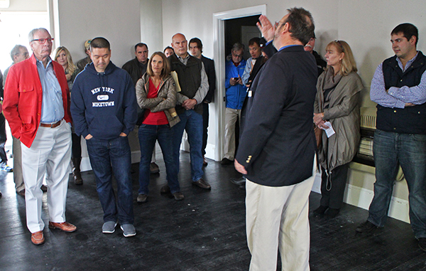 Bidders and spectators crowded into the Pie restaurant property's apartments at a Tuesday auction. Photos by Michael Thompson.