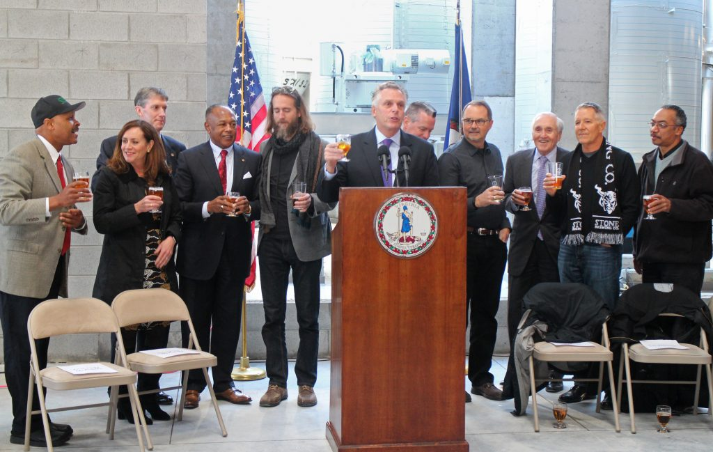Gov. Terry McAuliffe toasts to Stone's progress at a Friday event. Photos by Michael Thompson.