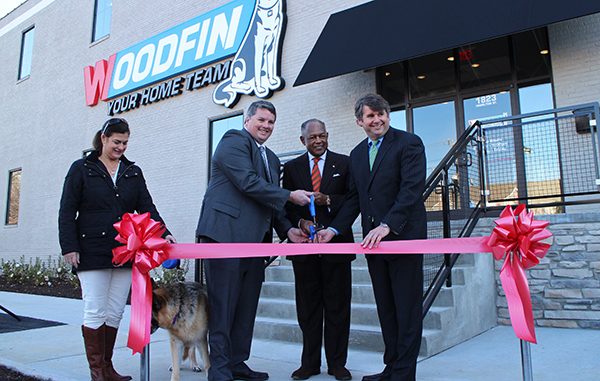 From left: Woodfin Presdient Justin Andress, Mayor Dwight Jones and Woodfin CEO Jack Woodfin cut the ribbon on the company's new location. Photo by Michael Thompson.