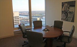 Large windows throughout the office show off top-floor views.