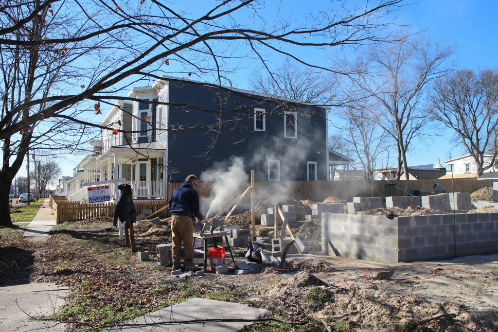 Crews work on the foundation of a new home on North 26th Street between S and T streets in Church Hill. Photos by Jonathan Spiers.