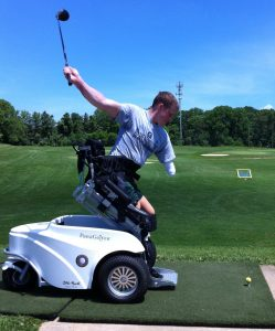 A golfer takes a swing with help from