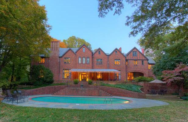 The Tudor Revival home includes an elliptical pool and gardens. Photos courtesy CVRMLS.