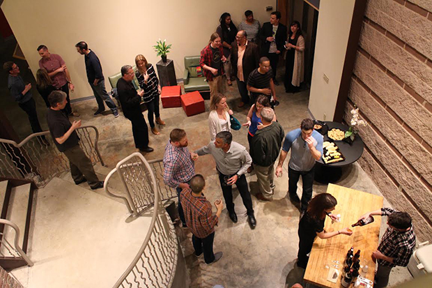 Attendees mingle before the concert at In Your Ear studio in Shockoe Bottom. Photos by Jonathan Spiers.