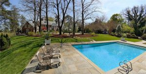 The 5-acre Summit property includes a pool and tennis court.
