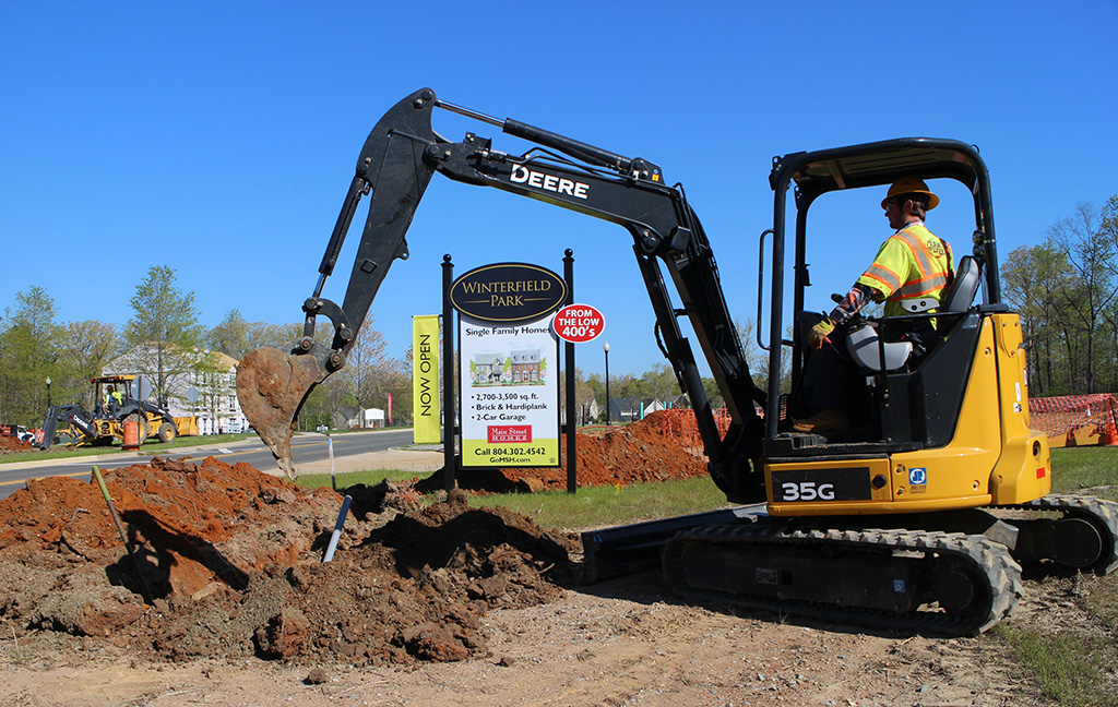 The bulldozer digs in at Winterfield Park last week. Photos by Jonathan Spiers.