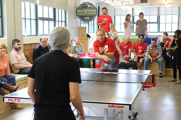 Players compete in the finals of the Shockoe Showdown ping pong tournament, held Friday in Shockoe Slip. Photos by Jonathan Spiers.