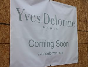 Yves Delorme has a sign announcing its arrival at River Road. Orvis does not.